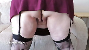 Short maroon microskirt and no knickers