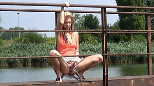 Pretty Light-haired Stunner Pisses Off Bridge Into River