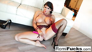 Smoking beauty Romi Rain takes care of her humid labia
