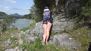 Without panties under a micro-skirt in nature. And a walk in a bathing suit outdoors. Fetish with spying for the yam-sized ass.