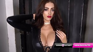 Delia Rose in latex catsuit & boots reveals her Immense tits