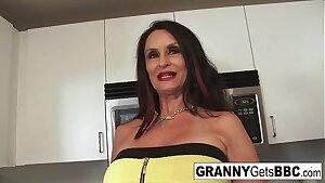 Busty brunette grannie takes the black cock in her humid pussy