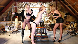 Two towheaded dominatrixes use their sex slave